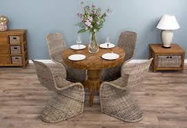 Reclaimed Teak Dining Table Reclaimed Teak Dining Table 1m Circular With Kubu Natural Wicker