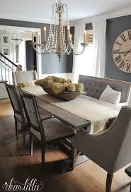 unexpected seating like this bench from homegoods help add character to this dark gray dining room and dried hydrangeas add a soft subtle touch in