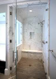 contemporary marble tiled walk in shower design with seating