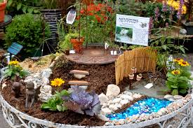 old table turned into magical miniature fairy garden