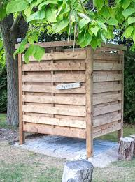 outdoor shower made with wood slats under a tree