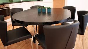 dark wood veneer extending dining table and contemporary chairs