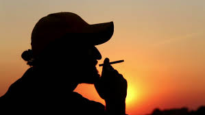 portrait of a lonely man smoking a cigarette at sunset a man smokes a cigarette