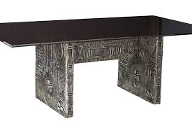 paying homage to paul evans sculpted bronze series this brutalist dining table