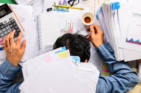 working too much stock photos pictures royalty working too working too much businessman heavy workload sleep at office desk finance sheet calculator and
