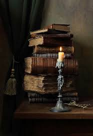 i would love to take this candle in hand and wander down the long hallway toward the library