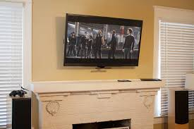mantelmount fireplace tv mount raised