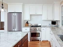 white kitchen idea with quartz countertops and brown floor
