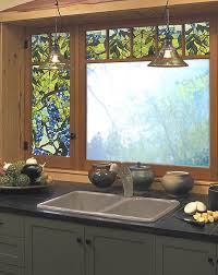chic kitchen cabinet with black countertop and sink plus faucet before the  window with artscape window