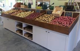 rustic wood dreyer farms market produce display fruit bins