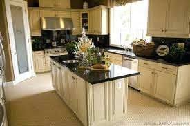 white cabinets dark countertops traditional antique kitchen black gray walls