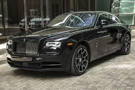 rolls royce wraith white and black. the 362700 rollsroyce wraith black badge costs 47000 more than standard rolls royce white and