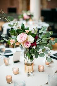 rose and eucalyptus centerpiece for occasional larger flower arrangements  to be used on tables so it's