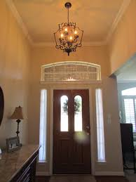 this beautiful entry is made even prettier with the addition of crown molding and the smallest revolution alder cage the detail provided compliments the