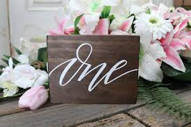 wooden table numbers white font
