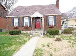 yellow brick house red door. front yellow brick house red door o