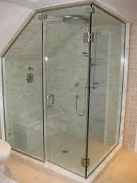 simple modern attic bathroom design with one piece tiled shower stalls with seats corner and slopping ceiling plus glass door ideas