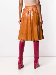 bottega veneta pleated glossed leather skirt in orange