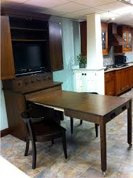wood mode pull out table to extend island bar to keep guests out of kitchen