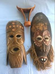lot of 2 african tribal masks and 1 wooden headrests from ethiopia