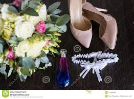 wedding concept wedding accessories bridal beige shoes perfume bottle wedding garter and