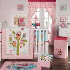 baby nursery cheerful room decoration using white crib and pink owl bedding also blanket combine with rug on the brown floor curtain of glass window cloth