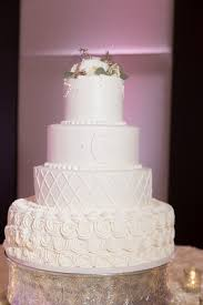 Four Tiered Round White Patterened Wedding Cake With White Floral
