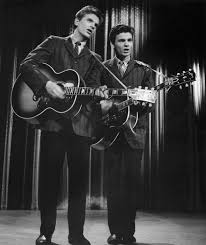 The musician, known for singing close harmonies with his brother, was 84. Rh8k6y Sgzk Qm