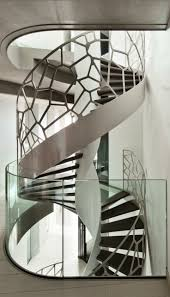 See-through spiral staircase with glass balustrade by Dutch manufacturer  EeStairs. - photo via ArchiEli fb page:
