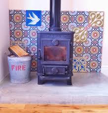 image result for wood burner concrete hearth no fireplace