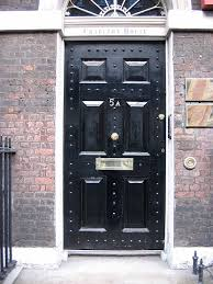 a mail slot letterbox in london located in the middle of the front door