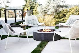 lochwood lozier outdoor patio with modern firepit and white chairs in clyde hill wa