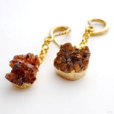 rough citrine druzy weights with gold electroplating hanging from br crossover hooks from oracle body jewelry