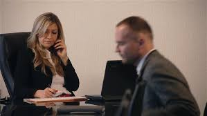 the office the meeting. Business People Talking On The Meeting In Office. Attractive Blonde Female Boss Speaking Phone And Writing Notebook. Young Male Manager Coming Office