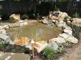 flagstone patio with fire pit. Pond With Irregular Flagstone Patio And Fire Pit - Pezzotti Brothers, Inc.