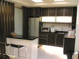 modern kitchen for small apartment with black countertop and white floor