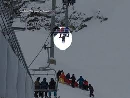 photo a boy who was dangling from a chairlift in whistler canda landed