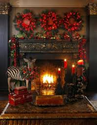 mantel lighting. cosy mantel display using festive red fairy lights and wreaths lighting i