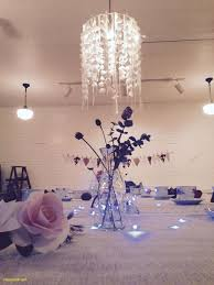 gorgeous handmade paper flower chandelier and crowns for a baby shower tea party planned and decorated