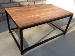 furniture rectangle brown wooden table with black wooden legs on the floor rustic look