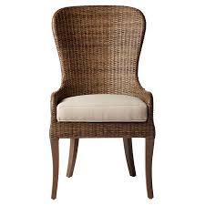 the subtle curves and high back of this rattan dining chair pair natural style with understated elegance chair