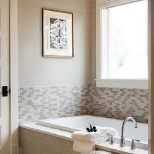 gray tiled tub with robert abbey beehive pendant