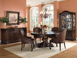 wooden round dining table design with 2 candles and showcase in room designs 17