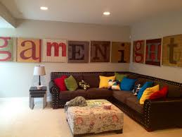 fun family room decor home fun family room wall art maybe we need a less ordinary living room one with personality and fun written all over it  on game room wall art ideas with fun family room decor home fun family room wall art maybe we
