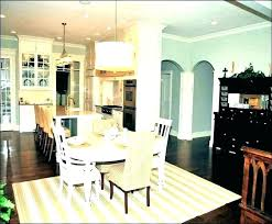 what shape area rug under oval dining table round rugs for size kitchen ta