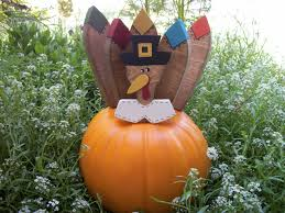 playful outdoor thanksgiving decoration idea with pumpkin design with  artificial leave with pop character in the