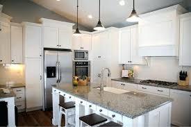 white kitchen cabinets gray granite countertops white