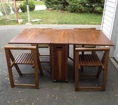 drop leaf dining table w 4 hideaway folding chairs. danish mid century modern drop leaf dining table self storing folding chairs vtg | ebay w 4 hideaway