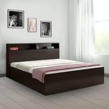 alex engineered wood box storage king size bed in dark walnut colour by hometown