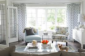 floral pattern living room chairs. example of a transitional enclosed dark wood floor living room design in vancouver with beige walls floral pattern chairs